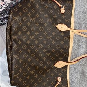 Louis Vuitton tote,zip ouch MK not included